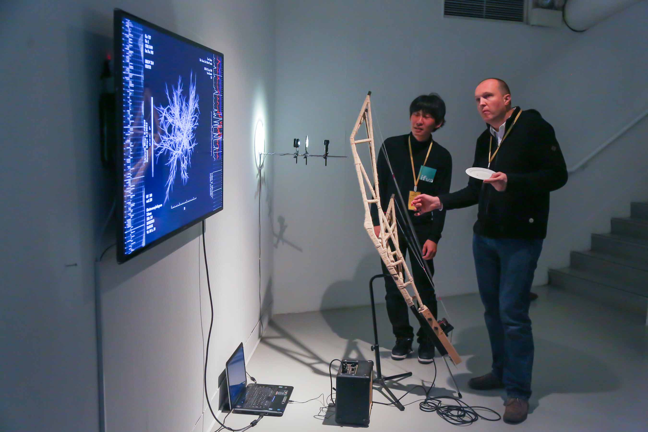 Yuto Hasebe was explaining his finalist work <i>Tree Guitar: The Trees, Our Blood Vessels</i> to Gebhard Sengmϋller