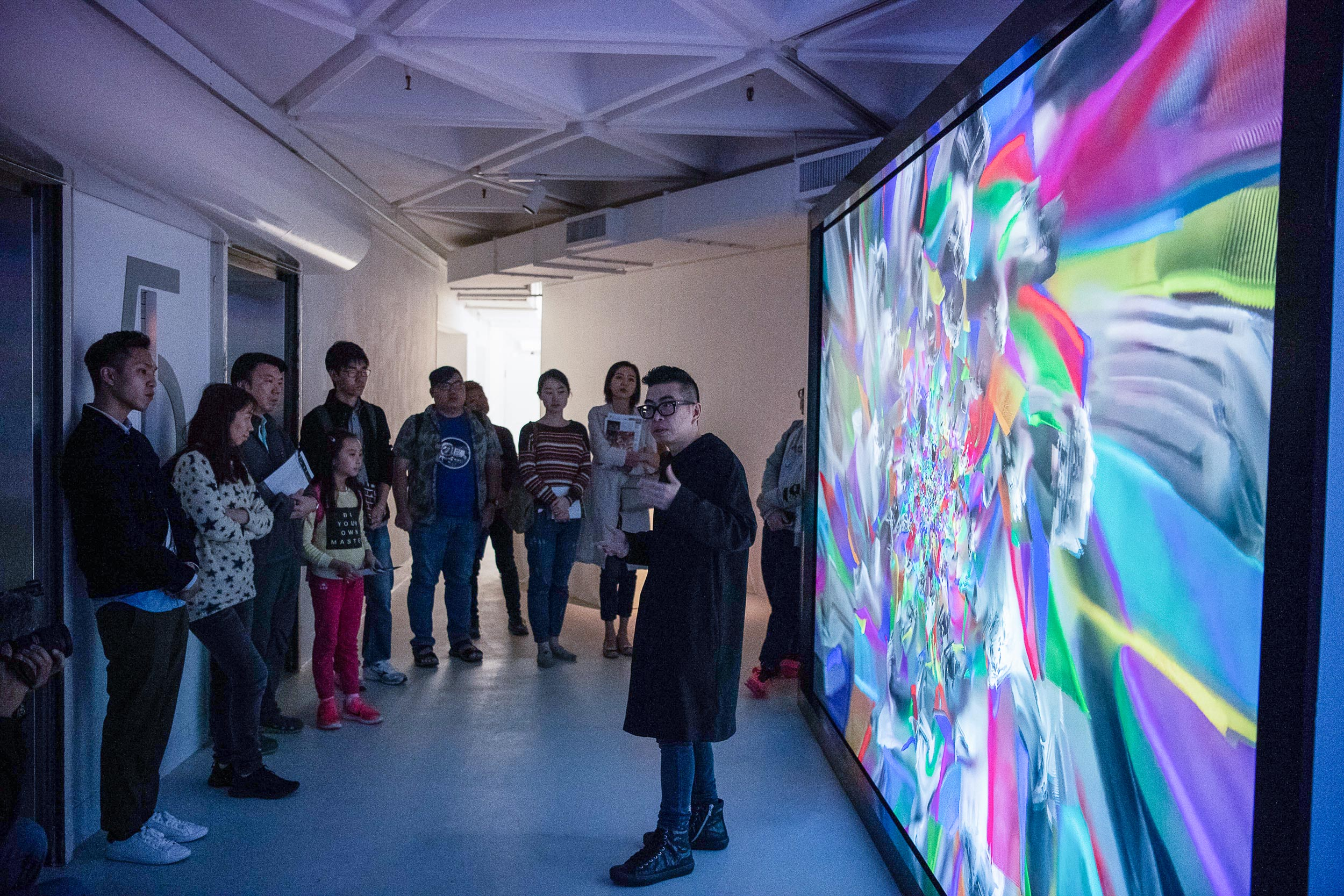 Curator Ip Yuk-yiu led the guided tour and shares with the visitor his curatorial concepts